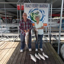 From left, Ed and Gerry Reynolds had a busy two days catching stripers on Norfork Lake during their recent visit.