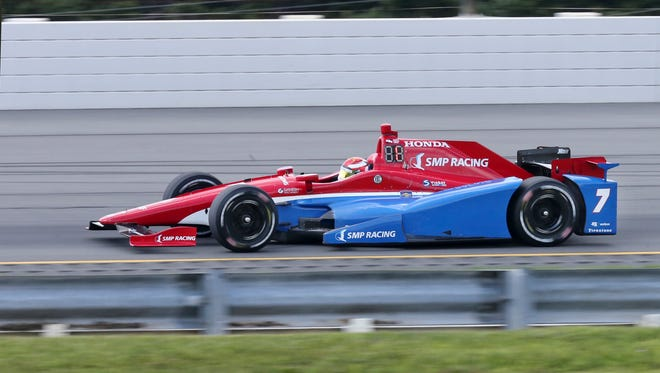 Mikhall Aleshin, of Russia, (7) drives during qualifying for Sunday's Pocono IndyCar 500 auto race Saturday, Aug. 20, 2016 in Long Pond, Pa. Aleshin qualified for the pole position in Sunday's race. (AP Photo/Mel Evans)
