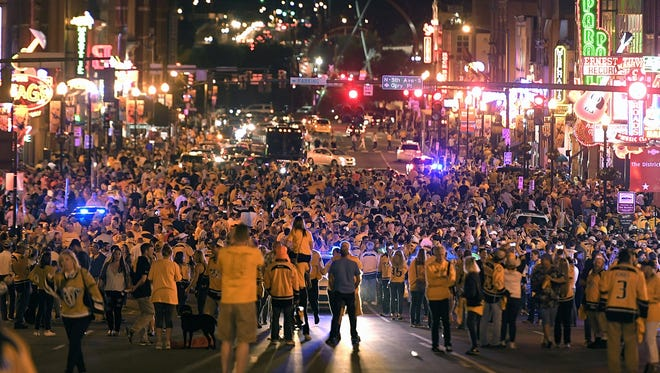 Predators fans celebrate on Broadway after the Predators beat the Ducks on Monday, May 22, 2017. The road will be shut down near Bridgestone Arena for Games and 4 of the Stanley Cup Final.