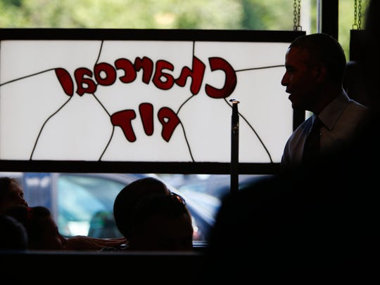 Former president Barack Obama stops by the Charcoal Pit on Concord Pike in 2014 after the suggestion of Wilmington native and adviser Dan Pfeiffer. Former Vice President Joe Biden also vouched for the iconic Delaware burger spot.