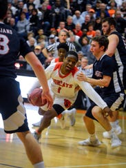 Fred Mulbah, above center, and the Northeastern Bobcats will begin their PIAA Class 5-A boys' basketball tournament run on Friday, March 9 at West York High School. DISPATCH FILE PHOTO