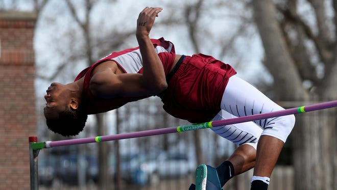 "Helena High's Trey Tintinger clears 6'9"" in the high jump during Friday's track meet against CMR at Memorial Stadium."