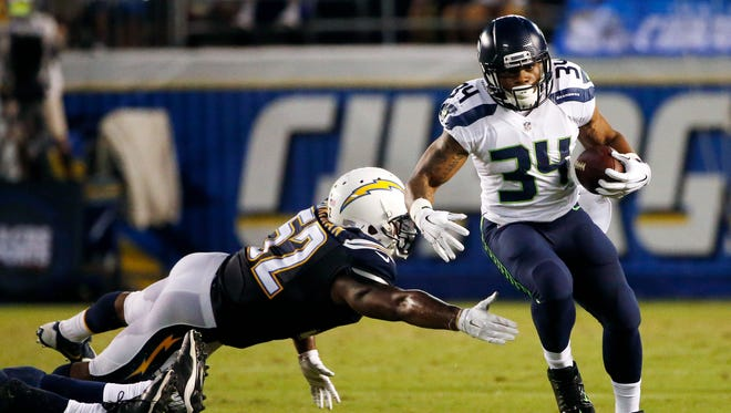 Seattle Seahawks running back Thomas Rawls, right, breaks away from San Diego Chargers inside linebacker Denzel Perryman during the second half of an NFL preseason football game Saturday, Aug. 29, 2015, in San Diego.