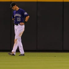 DENVER, CO - SEPTEMBER 2:  Center fielder Drew Stubbs #13 of the Colorado Rockies reacts after dropping a line drive during the eighth inning against the San Francisco Giants at Coors Field on September 2, 2014 in Denver, Colorado. The Giants defeated the Rockies 12-7. (Photo by Justin Edmonds/Getty Images)