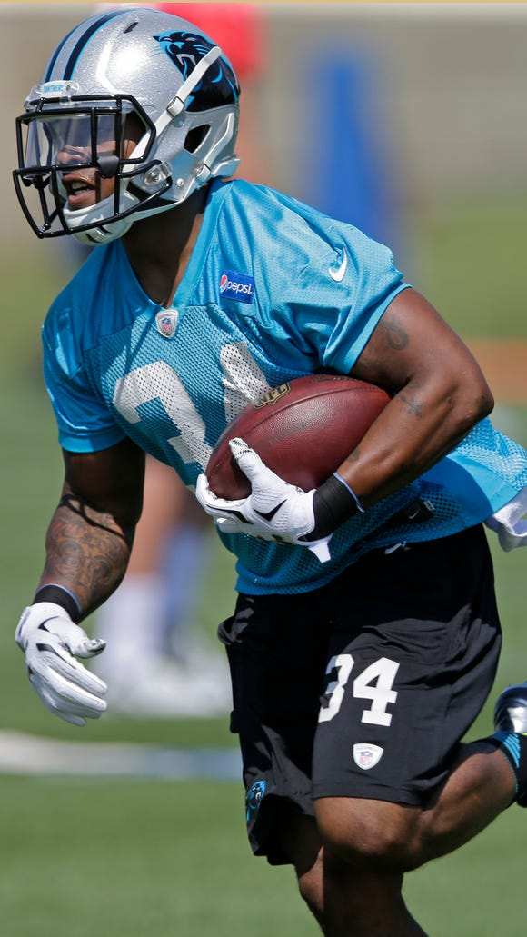 Carolina Panthers' Cameron Artis-Payne (34) runs a drill during a practice at the NFL football team's rookie minicamp in Charlotte, N.C., Friday, May 8, 2015.