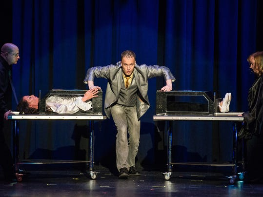 Magician and illusionist Jason Hudy performs a body splitting trick during the Hanover Exchange Club Evening of Comedy and Magic at the Eichelberger Performing Arts Center in 2014.