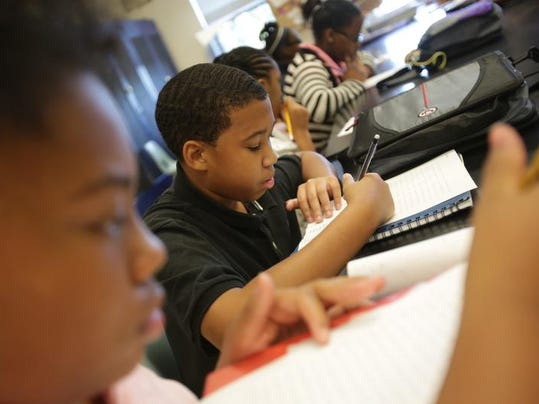 Anthony Stewart, 11 does some work in class at Levey Middle School in Southfield in September 2013.