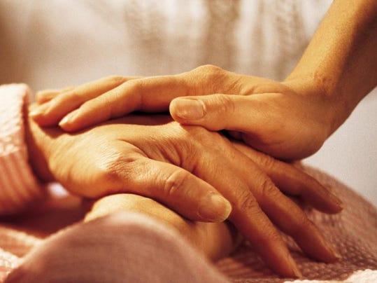 -end of life holding hands.jpg_20121212.jpg