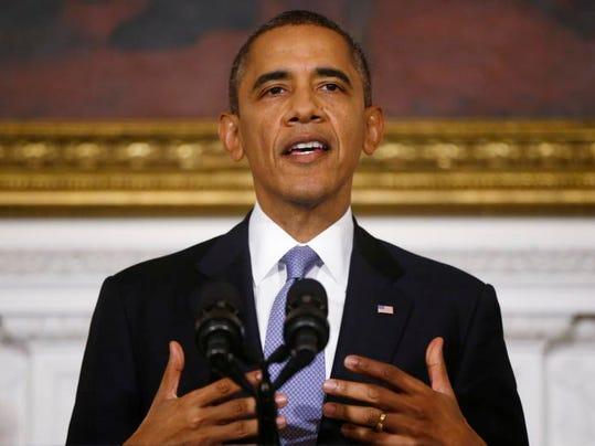 -ANIBrd_10-20-2013_TownTalk_1_A002~~2013~10~19~IMG_Obama_mug_11_1_RQ5E6LFU_L.jpg