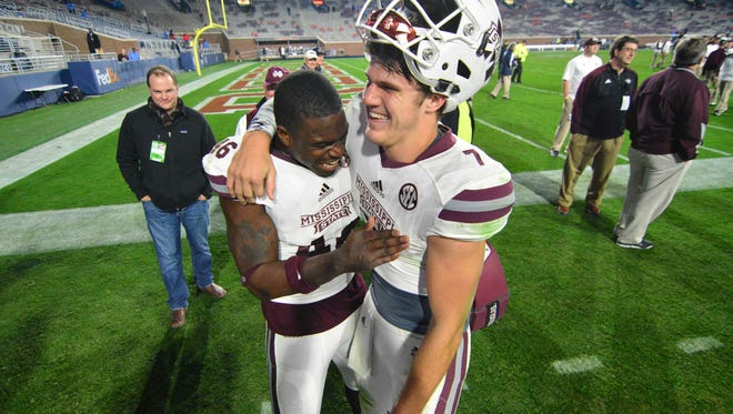 Mississippi State Bulldogs linebacker Dezmond Harris (46) and  quarterback Nick Fitzgerald (7) celebrate after the game against the Mississippi Rebels at Vaught-Hemingway Stadium. Mississippi State won 55-20.