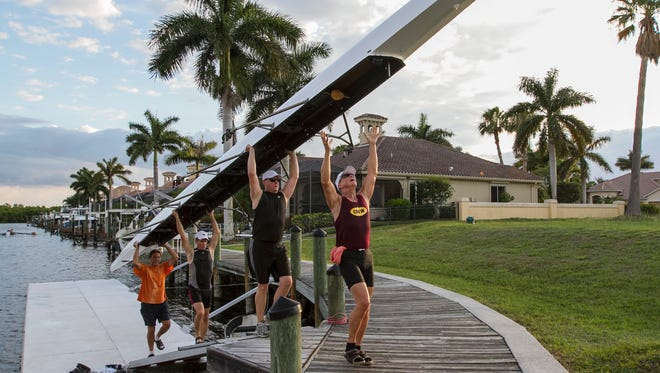 Members of the Caloosa Coast Rowing Club in Cape Coral practice along one of the canals near Cape Harbor Thursday, (5/26/16). Some  Club members were training for an upcoming race in Sarasota.