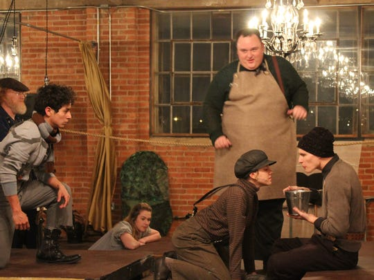 """Orphans Prentiss (Sierra Cowell, left) and Ted (Eric Evans) go face to face below Alf (Austin Bonham) aboard ship in this rehearsal scene from """"Peter and the Starcatcher,"""" a Paramount Theatre production to be performed Thursday and Friday at The Mill."""