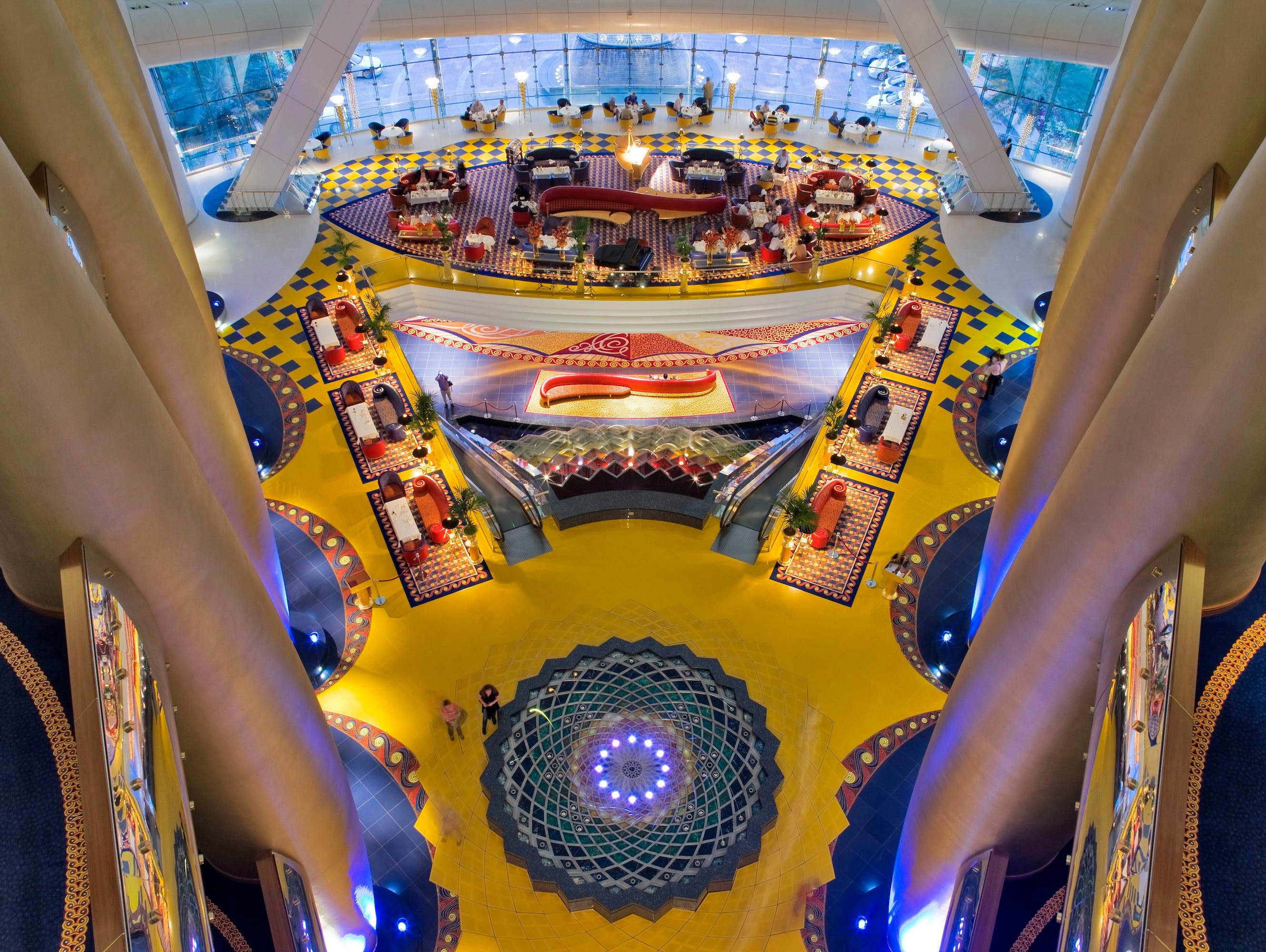 The Burj Al Arab in Dubai makes a splash not only from the skyline silhouette, but also with the colorful and eclectic lobby design.