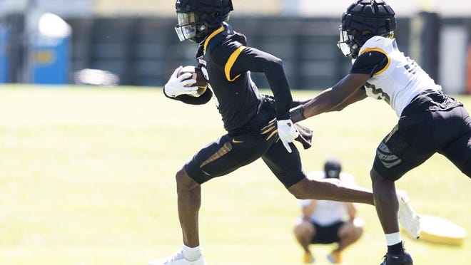 Missouri wide receiver Keke Chism (6) runs with the ball during practice at the Kadlec Practice Fields.