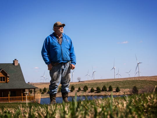 Mason Fleenor stands on his farm outside of Ida Grove Thursday, April 6, 2017. Ney doesn't like the looks or the noise of the turbines. Fleenor says the blinking lights keep him up at night.