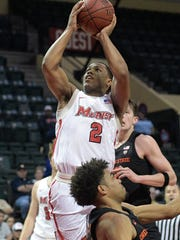 Marist guard Brian Parker shoots after colliding with