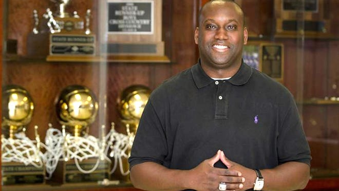 Harding's Kevin Starks has been named TSSAA basketball coach of the year after guiding the Lions to the Division 2-A state title