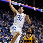 Kentucky's Derek Willis (35) goes up for a dunk near Ottawa's Zach Brown (10) during the second half of an NCAA college basketball exhibition game Monday, Nov. 2, 2015, in Lexington, Ky. Kentucky won 117-58.(AP Photo/James Crisp)