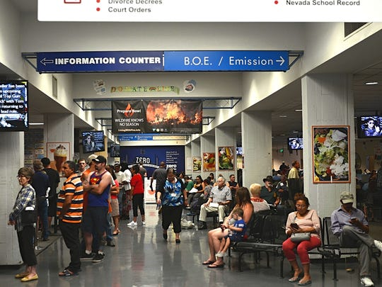 A crowd of people wait in line at the Nevada Department of Motor Vehicles on July 6, 2018. The long wait times were a result of a sever outage that led the agency to loose previously booked appointments.