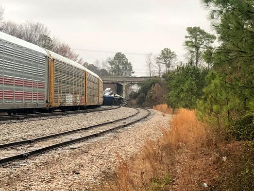 A derailed Amtrak train sits on the track in Cayce,