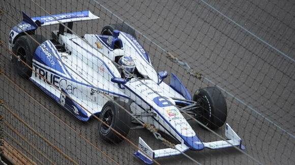The Dragon Racing car driven by Sebastian Saavedra scoots along the front stretch after damaging the front right wheel early in the race. The running of the 97th Indianapolis 500 was held May 26, 2013.