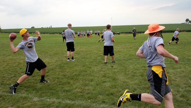 Lone Tree players run drills during their final day of camp on Friday, Aug. 8, 2014. David Scrivner / Iowa City-Press Citizen