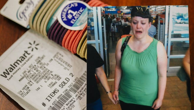 A family photo shows Jodi Kozma leaving Wal-mart after being accused of stealing hair ties. A receipt proves her innocence.