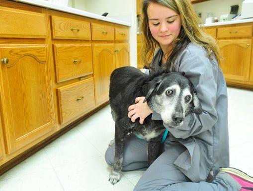 Sabrina Cornejo, 18, holds  Lita during an examination