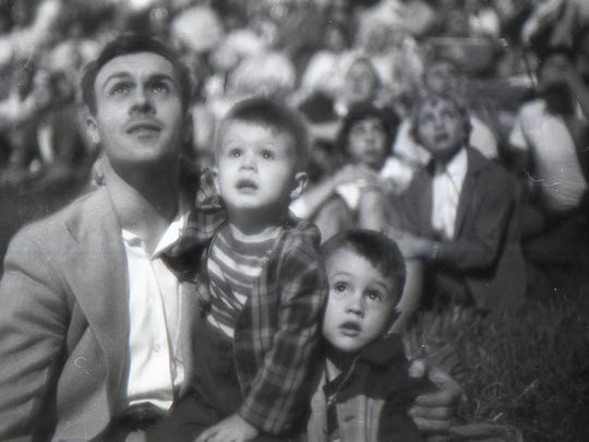 James Hartman, left holds his sons Barry and Lester as they watch the fireworks at Coleman Memorial Park to celebrate Independence Day in July 1954. This photo appeared in the July 6, 1954, edition of the Lebanon Daily News