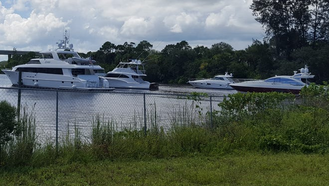 Boats and yachts of all shapes, sizes and value wait patiently in line downstream of the St. Lucie Lock and Dam in September 2017 as they prepare for Hurricane Irma's Florida arrival.