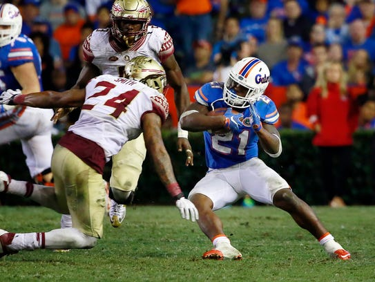 Terrance Smith prepares to tackle UF's Kelvin Taylor.