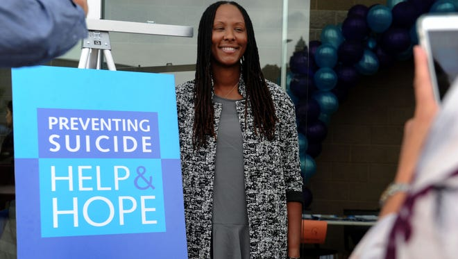 Chamique Holdsclaw, former WNBA basketball star, poses for photos after telling her story at a suicide prevention conference in Oxnard.
