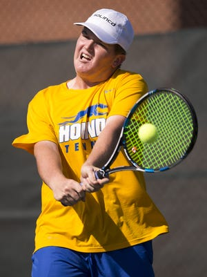 Patrick Fletchall, shown here Sept. 26 helping Carmel win team state title, picked up his second-straight individual title Saturday.