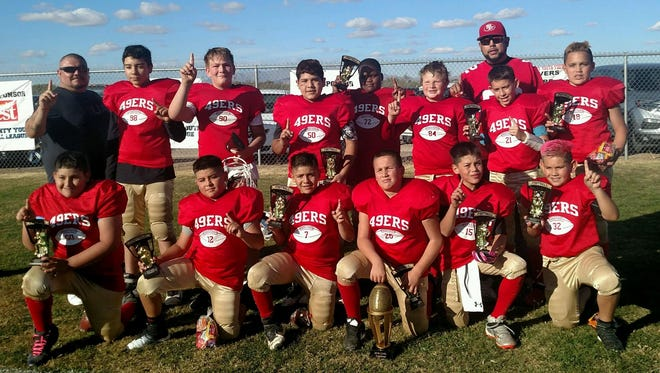 The Forty-Niners held off a tough Panthers team to claim the Super Bowl Championship in the 10-12 age division of the Luna County Youth Football League. The 'Niners took a 12-6 victory in front of a boisterous fan base at Shirley Sayre Memorial Fields in Deming's Industrial Park (Raymond Reed Blvd.) The team is ( in no order) Aiden Kern, Ethan Nevarez,Timmy Sanchez, Damian Vargas,Symon Hernandez, Sammy Perez, Davien Guerra, Anthony Cordova, Kaleb Mendoza, Aiden Jaquez and Xavier Almanza, Coaches are Lonnie Almanza, head coach; and assistant coaches Carlos Jaquez and Carlos Apodaca.