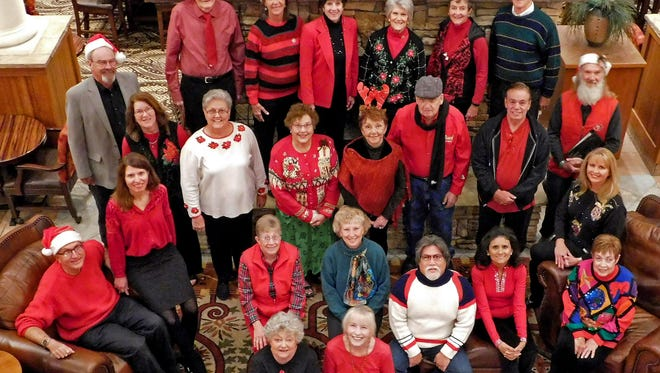 Members of the ENMU-Ruidoso Choir are captured for a group photo at the MCM Elegante Lodge in Ruidoso,