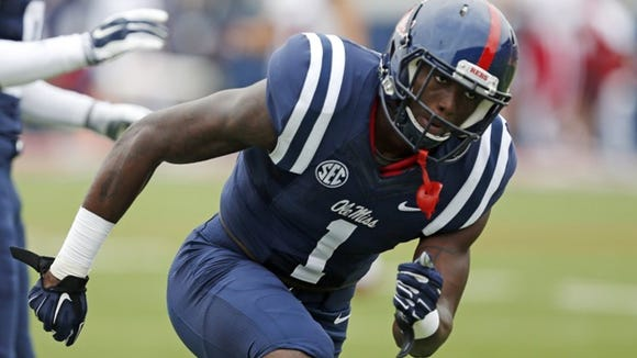 Mississippi wide receiver Laquon Treadwell (1) runs a receiving drill during pre-game warmups prior to an NCAA college football game against Louisiana-Lafayette at Vaught-Hemingway Stadium in Oxford, Miss., Saturday, Sept. 13, 2014. (AP Photo/Rogelio V. Solis)