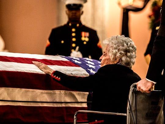 Widow Annie Glenn says goodbye to her husband, Sen. John Glenn as he lies in honor in the Statehouse rotunda.