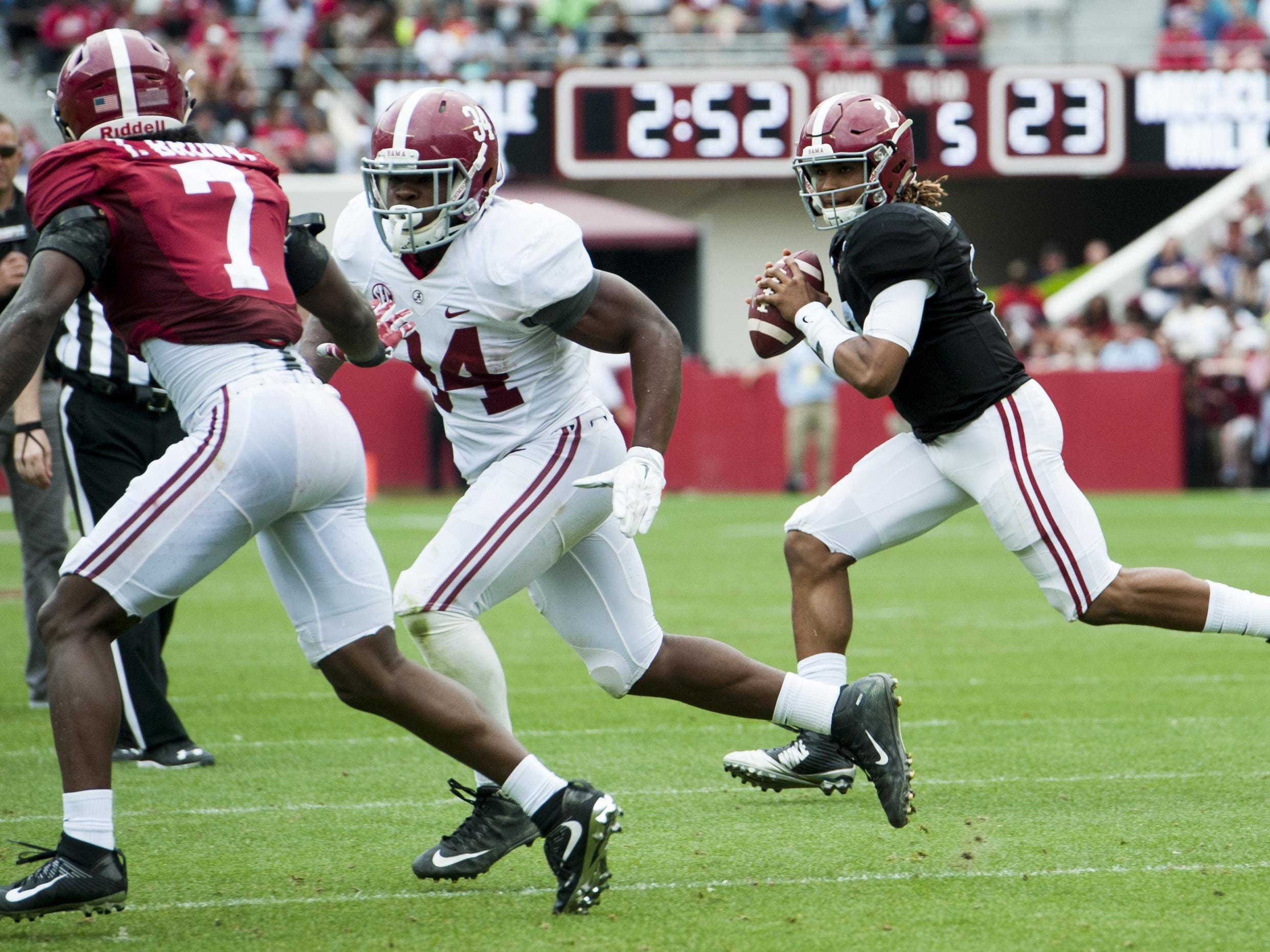 Alabama quarterback Jalen Hurts rolls out behind the blocking of running back Damien Harris (34) during the Alabama A-Day spring football game at Bryant-Denny Stadium on April 16, 2016.