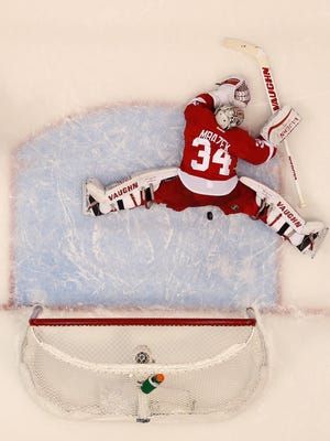 Petr Mrazek #34 of the Detroit Red Wings makes a second period save while playing the Tampa Bay Lightning in Game Six of the Eastern Conference Quarterfinals during the 2015 NHL Stanley Cup Playoffs at Joe Louis Arena on April 27, 2015 in Detroit, Michigan. Tampa Bay won the game 5-2 to tie the series 3-3.