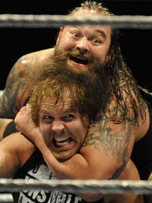Bray Wyatt gets the upper hand on Dean Ambrose during a WWE event at Garrett Coliseum on Jan. 10.
