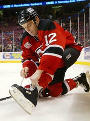 Jim Dowd ties his skate during a 2006 Devils game against the Montreal Canadiens.