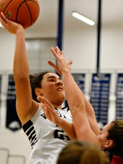 West York's Angie Hawkins takes the ball to the net during basketball action against New Oxford at West York High School in West Manchester Township, Monday, Jan. 9, 2017. Dawn J. Sagert photo