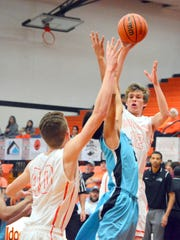 Artesia's Caleb Dean passes the ball to teammate Joe Willingham (40) in the second quarter Saturday.