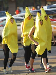 Students dressed as a bunch of bananas take part in
