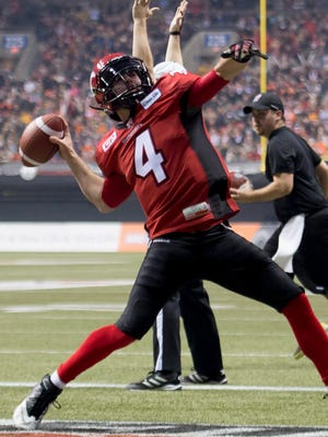 Calgary Stampeders quarterback Drew Tate, a former star at Iowa, celebrates a touchdown during the CFL Grey Cup championship football game against the Hamilton Tiger-Cats in Vancouver, British Columbia, Sunday, Nov. 30, 2014.