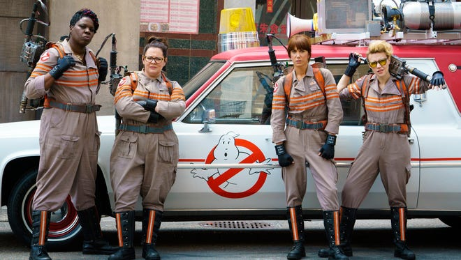 "In this image released by Sony Pictures, from left, Leslie Jones, Melissa McCarthy, Kristen Wiig and Kate McKinnon appear in a scene from the film, ""Ghostbusters."""