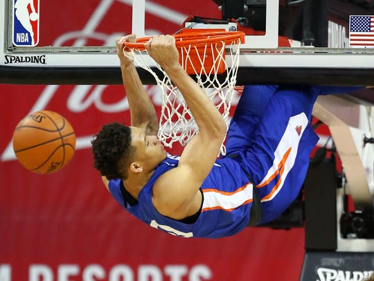 July 7: Knicks forward Kevin Knox hangs from the rim