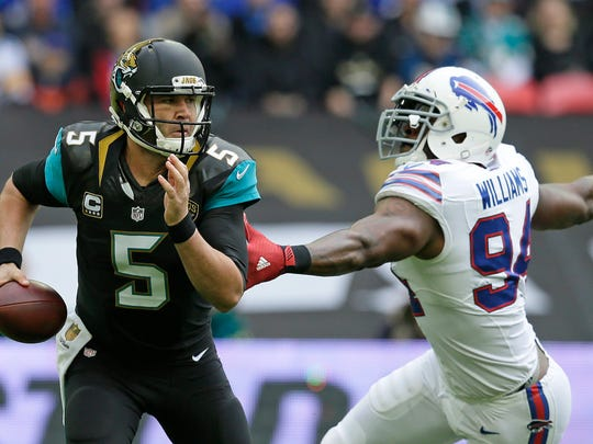 Jacksonville Jaguars quarterback Blake Bortles (5) alludes the challenge of Buffalo Bills defensive end Mario Williams (94)during the NFL game between Buffalo Bills and Jacksonville Jaguars at Wembley Stadium in London,  Sunday, Oct. 25, 2015.