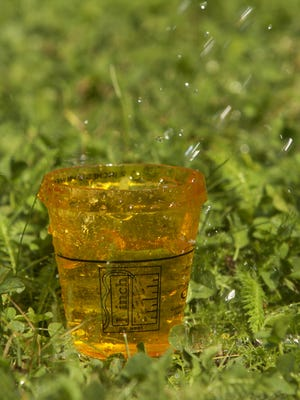 A 1-inch rain gauge supplied can tell you how much water you are using on your lawn.