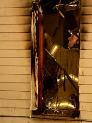 Officials work the scene of a house fire at 217 rear Carlisle Street in Hanover, Monday, March 7, 2016.
